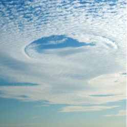 circles in the clouds and sky are known as fallstreak holes or hole punch  clouds